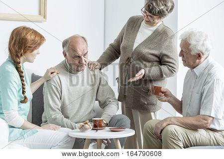 Elder people talking with doctor at nursing home