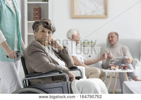 Upset Woman On Wheelchair