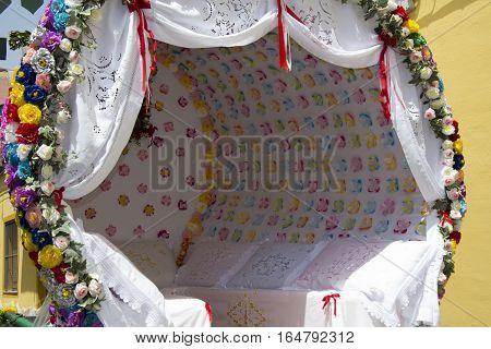 QUARTU S.E., ITALY - July 28, 2012: Feast of St. John - Sardinia - detail of a traditional Sardinian cart (traccas) decorated with flowers