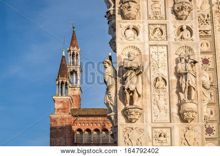 Awesome marble statues from the Renaissance period of the Pavia Carthusian monastery at sunsetItaly.