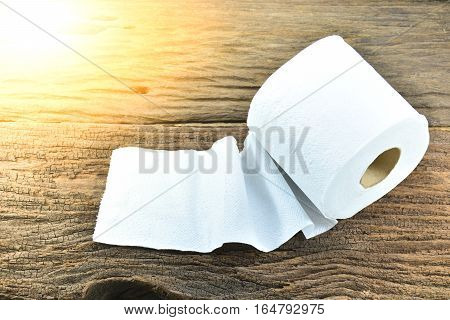 White tissue paper put on the old bark, wood under the sunlight