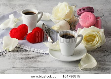 Couple White Cups With Decoration By Red Hearts On Wooden Table. Valentine's Day Celebration Concep