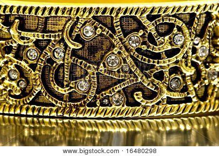 close-up of gold bracelet with diamonds