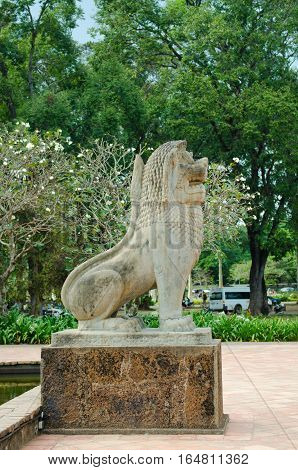 stone statue of a lion sitting in Cambodia