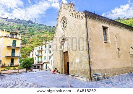 Manarola town Riomaggiore La Spezia province Liguria northern Italy. View of the San Lorenzo church monument landmark. Part of the Cinque Terre National Park and a UNESCO World Heritage Site.