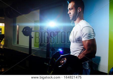 Bodybuilder Pumping Up Hands In Gym