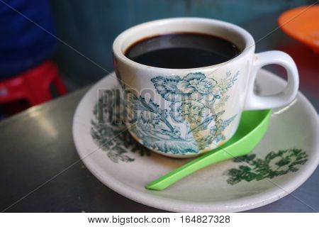 Steaming Traditional Oriental Chinese Style Dark Coffee