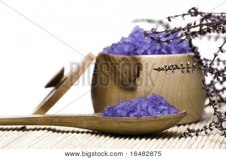 Spa essentials (bath salt in a spoon and flowers of lavender)