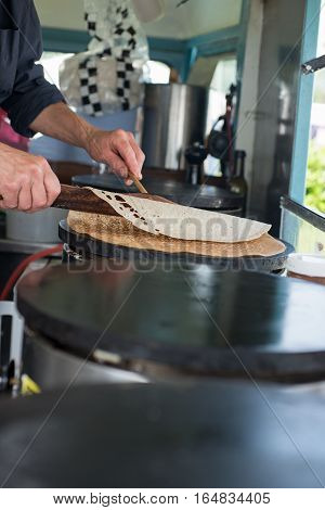 Flipping Crepe With Wooden Scraper And Spreader
