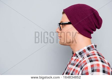 Side View Of Handsome Confident Hipster Man In Violet Cap And Glasses