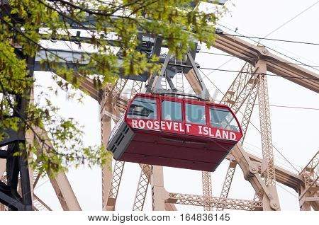 NEW YORK - MAY 3 2016: cable car of the roosevelt island tramway. Each cabin accommodates a capacity of 125 people makes approximately 115 trips per day and about 100 on weekends.
