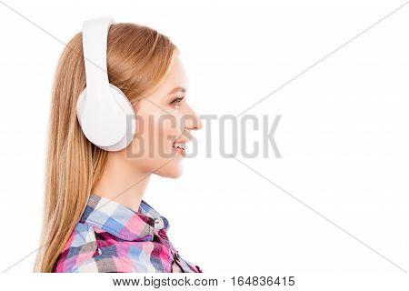Side View Of Happy Pretty Blonde Woman  In Headphones