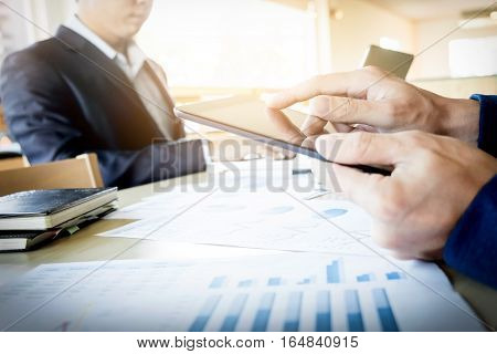 Businessman Working With Digital Tablet Computer And Smart Phone And Laptop