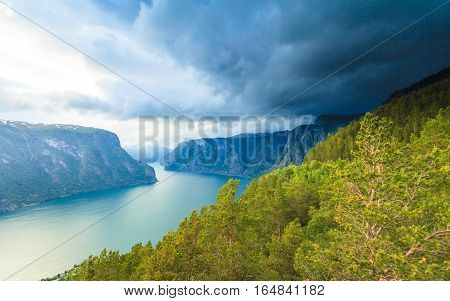 Tourism and travel. Scenic nature landscape. View to picturesque Aurlandfjord and Sognefjord from Stegastein viewpoint Norway Scandinavia.