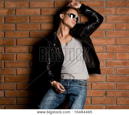 fashionable man near the wall