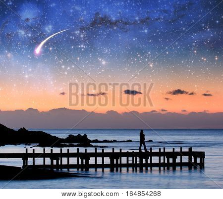 Fantasy Landscape - Silhouette Of A Woman Walking On Pier Admiring Stars In The Sky.