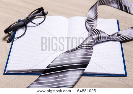 Business Concept - Blank Notebook, Glasses And Tie