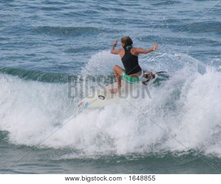 Girls can surf too. Surfing in the