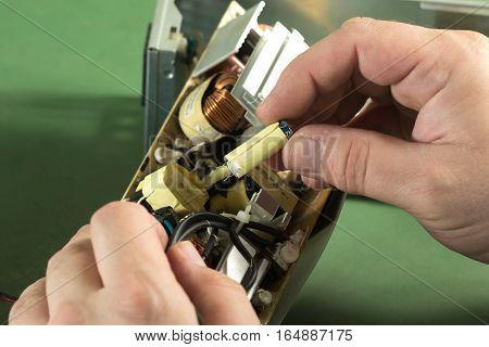 Technician repair circuit board and replace capacitor