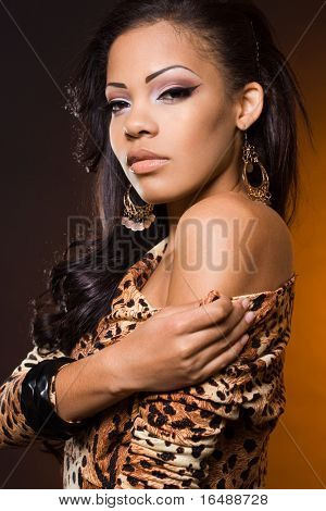fashionable mulatto woman on orange