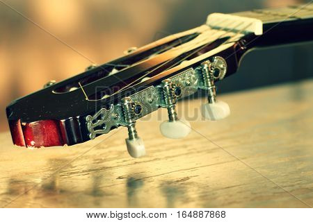 Detail of Burgundy wooden guitars. Detail of the Spanish guitar. Picture of the music string instrument.