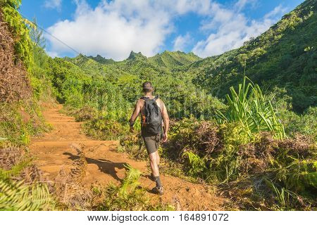 Hiker in Kalalau trail, Kauai Island, Hawaii