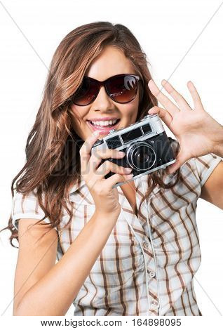 Young woman taking photos with vintage film camera