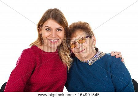 Picture of a kind woman helping an old lady - isolated background
