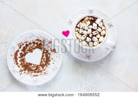 Valentine day decoration breakfast white vintage cup and plate coffee with small marshmallows and hearts made from red paper and grated chocolate. Top view flat lay.