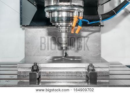Industry machine precision part by CNC machine center working in factory.