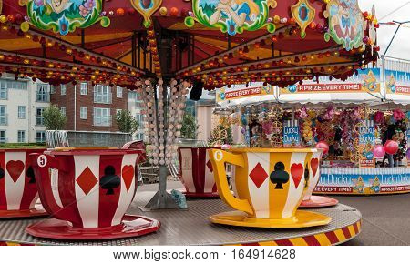 Minehead UK - July 27 2016: view of tea cups carousel at Minehead fairground in UK.