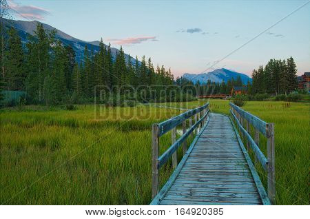 Beautiful Sunset in town of Canmore. Boardwalk Policeman Creek