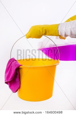 Woman Pouring Detergent Into Bucket On White Background