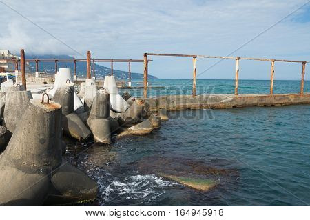 Bank tetrapods on the shore of the Black sea. Pier.