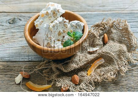Wooden Bowl With Almond Nougat.