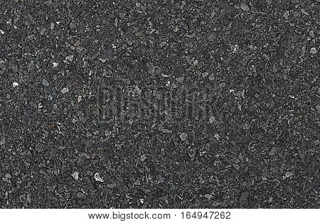 The gray background of black asphalt road.
