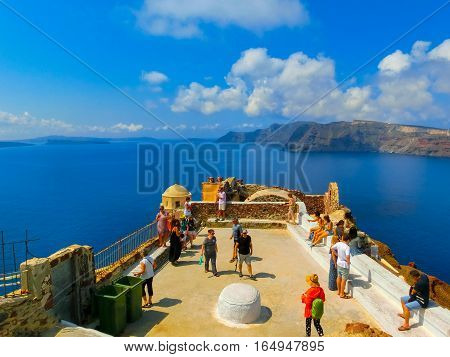 Oia Greece - June 10 2015: Santorini - The people walking at beautiful terrace with sea view on Santorini island Oia Greece on June 10 2015.