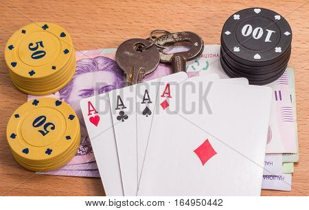 always nice to win chips for poker and old metal keys Soviet times on a wooden background