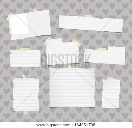 Ripped white ruled note, notebook, copybook paper sheets stuck with yellow sticky tape on pattern created of heart shapes.