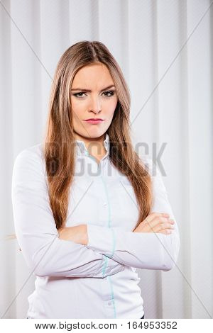 Angry Business Woman With Crossed Arms.