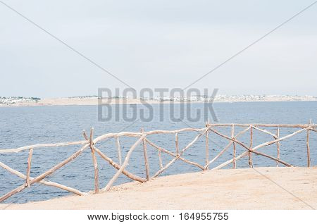 Beach. Calm Sea Ocean And Blue Sky Background. Exotic water landscape with clouds on horizon. Natural tropical water paradise. Travel tropical island resort. Ocean nature tranquility. Red sea