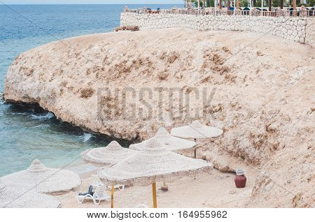 Beach. Calm Sea Ocean And Blue Sky Background.Exotic water landscape with clouds on horizon. Natural tropical water paradise. Travel tropical island resort. Ocean nature tranquility. Red sea