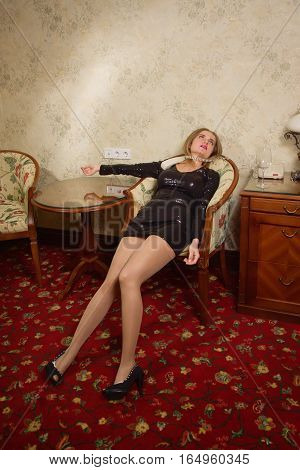 Strangled Beautiful Woman In A Black Dress In A Bedroom