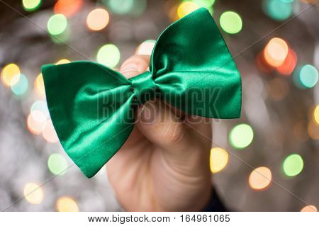 Male Hand Holding A Green Bow Tie.