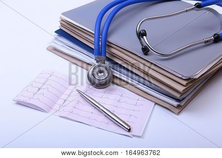 Folder file and stethoscope on the desk.