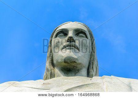 RIO DE JANEIRO, BRAZIL - JANUARY 07, 2017: Head of Christ the Redeemer on the background of blue sky
