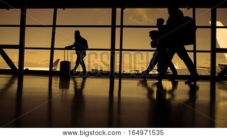 Passengers waiting to boarding. A sunny day blue sky on the background, silhouette, warm, wide angle
