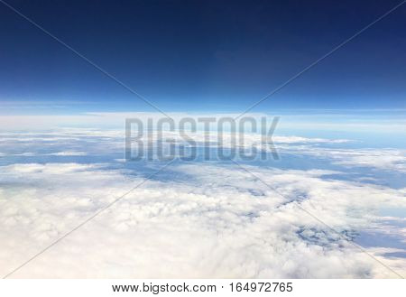 Aerial view from the airplane.Above the sky horizon.World explorer cover