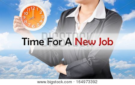 Time for a new job and business woman holding clock on blue sky background. Business concept.