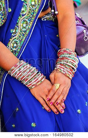 Close-up of woman's hands with bangels Agra Fort Uttar Pradesh India. The fort was built primarily as a military structure but was later upgraded to a palace.